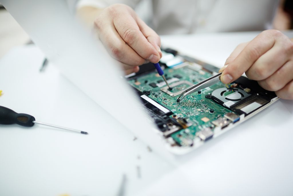 Closeup of Fixing Disassembled Laptop