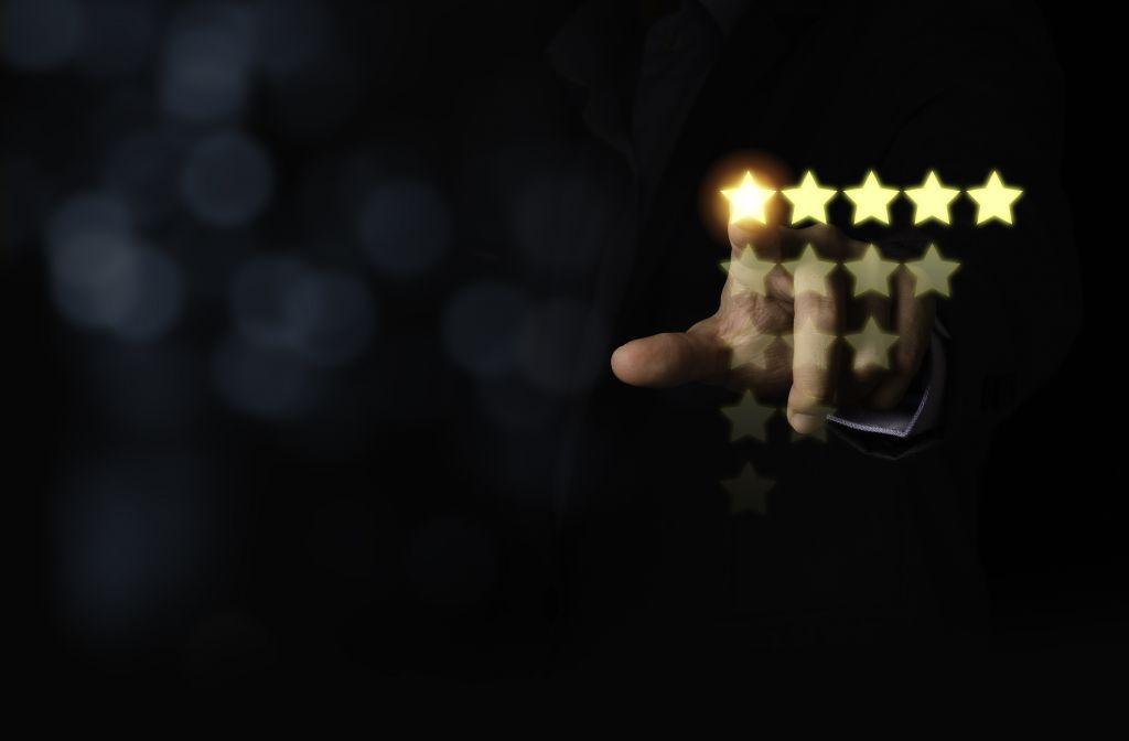 hand touching to 5 stars virtual